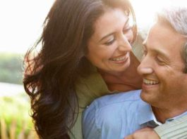 middle-age-couple-smiling-hugging-16-x-9